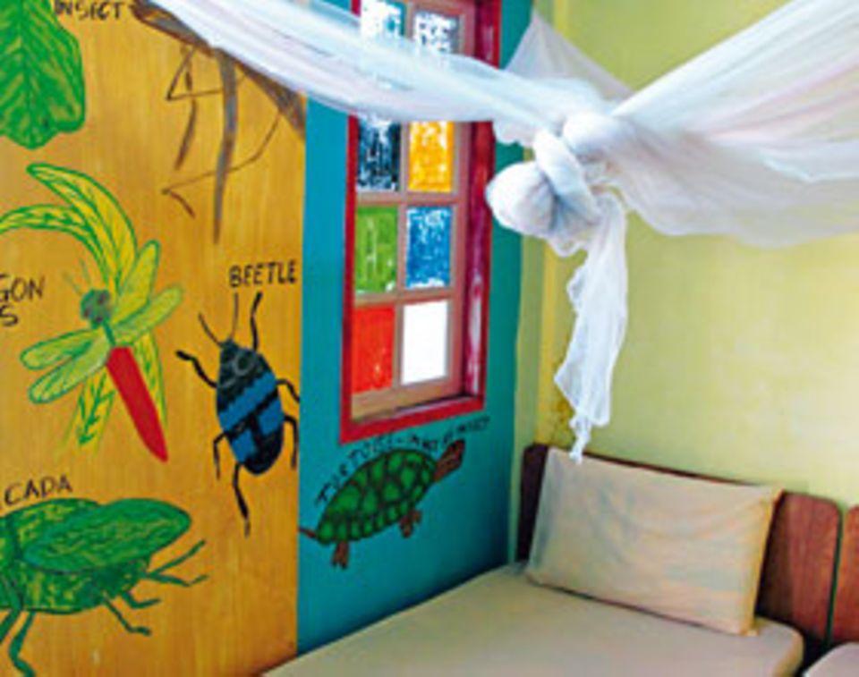 """Backpacking: Im """"Tahan Guest House"""" wimmelt es vor Tieren - zum Glück sind sie nur gemalt"""