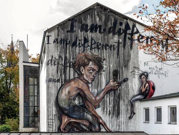 Deutsches Künstlerduo Herakut: Der kreative, aber machthungrige Junge Jay ist der Star des Wandbildes in St. Ottilien, nahe Augsburg.
