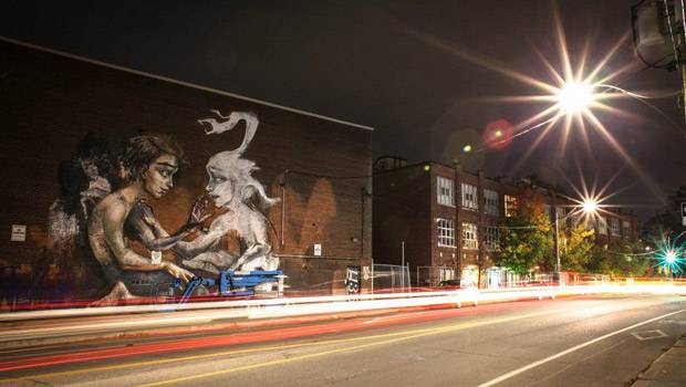 Deutsches Künstlerduo Herakut: Vier bis fünf Tage dauert es, bis ein Graffiti wie das in Toronto in Kanada fertig ist.