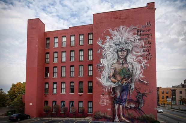 Deutsches Künstlerduo Herakut: Die Stadt Rochester in den USA wird nun von Herakuts grimmigen Riesen bewacht.