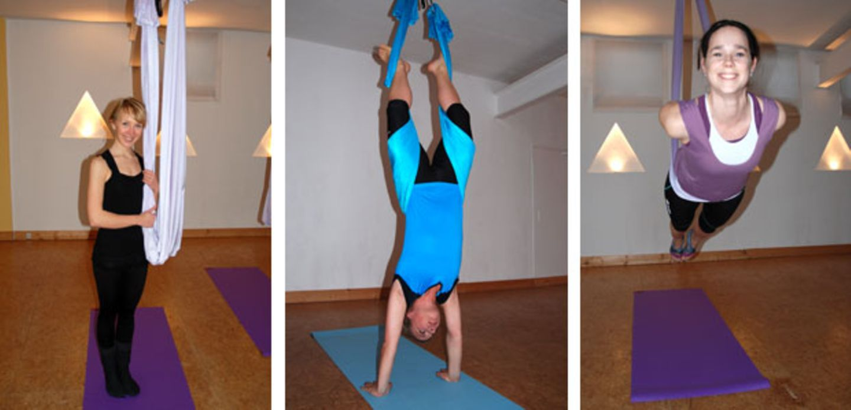 Trainerin Sonja Ehrlich (links) zeigt den BRIGITTE-Redakteurinnen Nicole und Dani, wie sie ihr Powerhouse in der Schwebe trainieren.