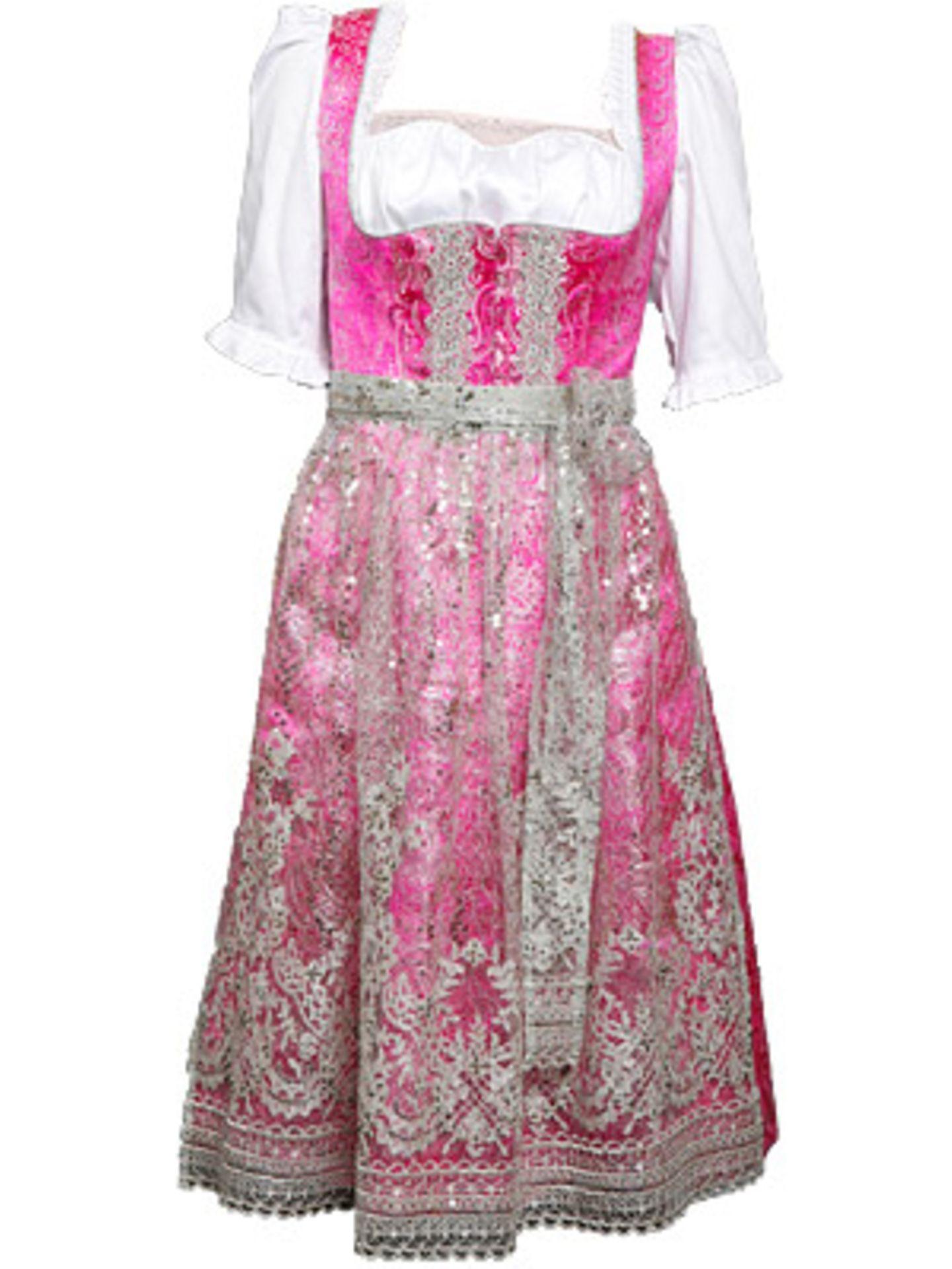Aufwendig besticktes Dirndl in Pink von Berwin & Wolff, um 330 Euro. Bluse um 70 Euro.