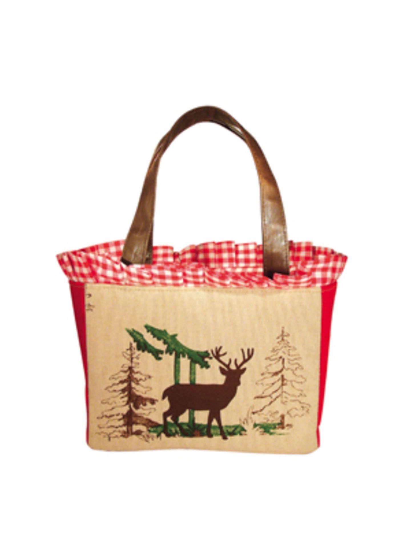 Kleine Unterarmtasche mit Hirschmotiv von Mandana Just Bags, um 170 Euro.