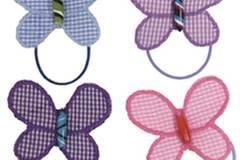 Frühling am Kopf: Haargummis mit Schmetterlingen von Bertine, ca. 3,50 Euro, in vielen verschiedenen Farben erhältlich. Zu Bestellen über www.bertine.de