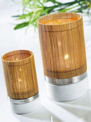 Teelichthalter    Edles Teelichthalter-Set für entspannende Momente. Aus Porzellan, Edelstahl und Bambus gefertigt.    Preis: ca. 22,50 Euro, über  www.otto.de