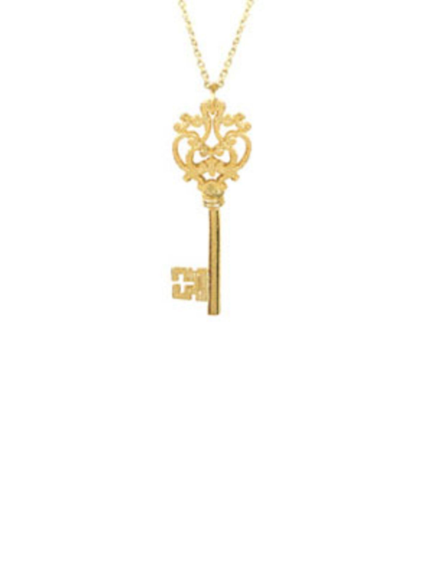 Goldfarbene Kette mit großem verschnörkelten Schlüssel von www.fredflare.com, um 10 Euro.