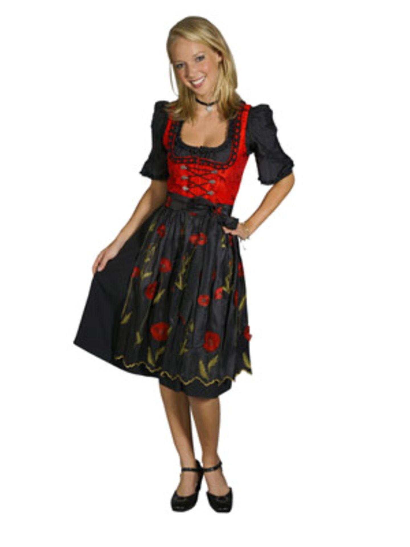 Knielanges Dirndl in Schwarz und Rot mit Blumenapplikation auf der Schürze von Wirkes. Ca. 130 Euro. Über www.trachtenshop.de