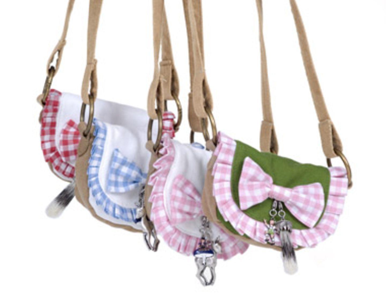 Witzige Umhängetaschen mit bayrischem Flair in verschiedenen Ausführungen von Mandana Just Bags, je um 110 Euro.