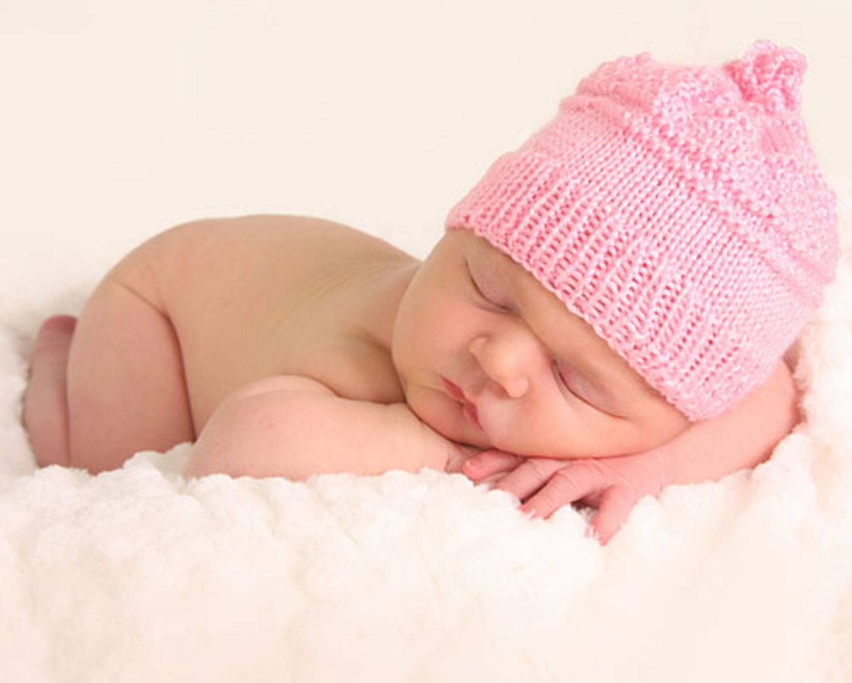 Baby mit Mütze