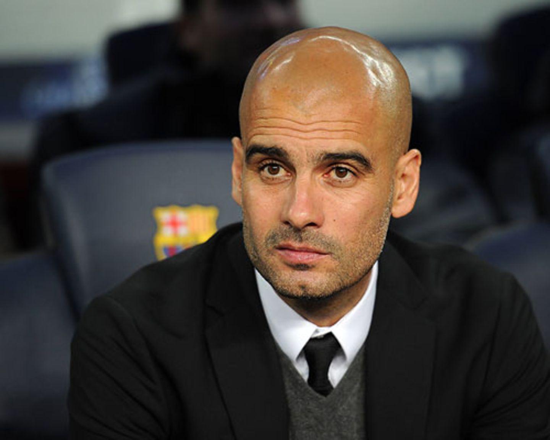 Schwarzer Designer-Anzug, passende Krawatte und ein tadelloser Dreitagebart: Nicht nur als Trainer pflegt Guardiola seinen ganz eigenen Stil.