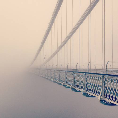 Bridge disappearing into the fog