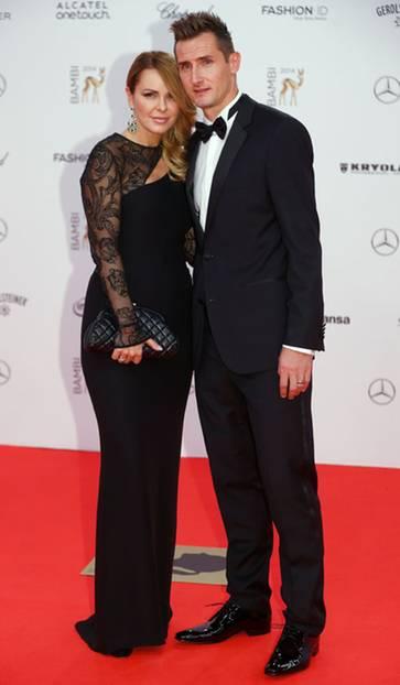 Stilkritik: Auch Fußballspieler Miroslav Klose und seine Ehefrau setzten modisch auf Schwarz. Eine gute Entscheidung, finden wir.