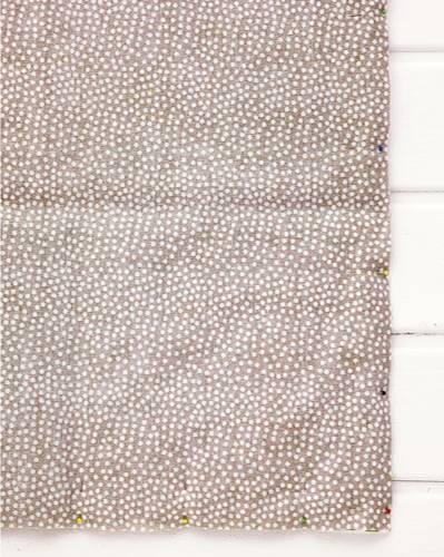 Futterzuschnitt auf Oberseite der gesteppten Decke auflegen
