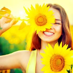 Stefanie stahl erklärt das Sonnenkind: Frau mit Sonnenblume