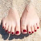Schrunden: Füße im Sand