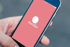 Balloon App: Hand mit Handy