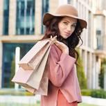 Reklamation: Frau mit Einkaufstüten