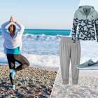 Plus Size Sportmode: Frau beim Pilates am Strand