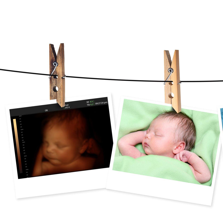 Kinderbilder hängen an Wäscheleine