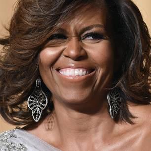 Präsidenten-Gattin Michelle Obama mit einem fröhlichen Lachen im Gesicht