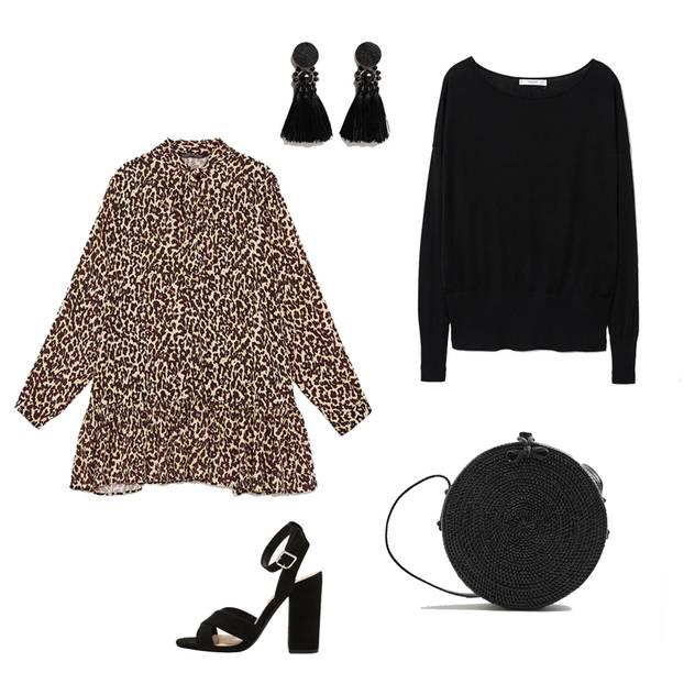 Wer sich für ein Kleidungsstück mit Animalprint entscheidet, der sollte das restliche Outfit eher schlicht und einfarbig gestalten. In diesem Fall steht das kurze Kleid mit Leo-Muster im Vordergrund. Das hat einen Saum mit schönen Volants und am Ausschnitt eine große Schluppe. Um das Minikleid alltagstauglich zu stylen, kombinieren wir einen locker geschnittenen schwarzen Pullover mit Rundhalsausschnitt dazu - oben darf die Schluppe locker aus dem Ausschnitt schauen. Dunkle Sandaletten, die schwarze Box-Bag aus angesagtem Bambus und Ohrringe mit Quasten runden den Look ab. Trés chic!