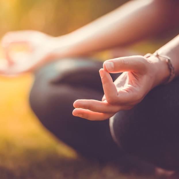 Mini-meditation: hands of a meditating person