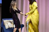 Promi-Looks: Michelle Obama im gelben Kleid mit goldenen Stiefeln