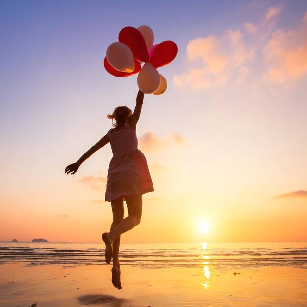 Ellen Langer: A woman with balloons by the sea