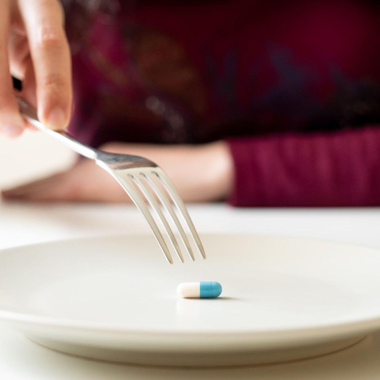 HCG Diät: Pille auf Teller