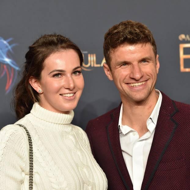Thomas und Lisa Müller auf dem roten Teppich