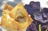 Frittierte Ravioli mit Ziegenkäse-Zucchini-Füllung