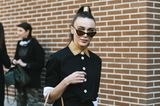 Trendfrisuren für den Sommer: Frau mit hohem Zopf