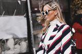 Frisuren mit Haarspangen: Frau mit Sonnenbrille und offenen Haaren