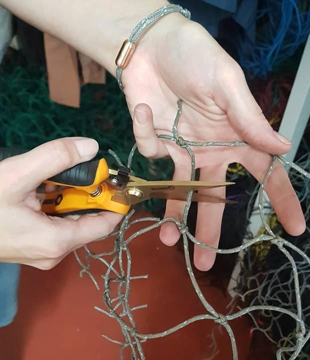Bracenet: Zerschneiden der Fischernetze