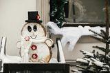 Schneemann basteln: Schneemann aus Baumscheiben