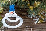 Schneemann basteln aus Spiralen