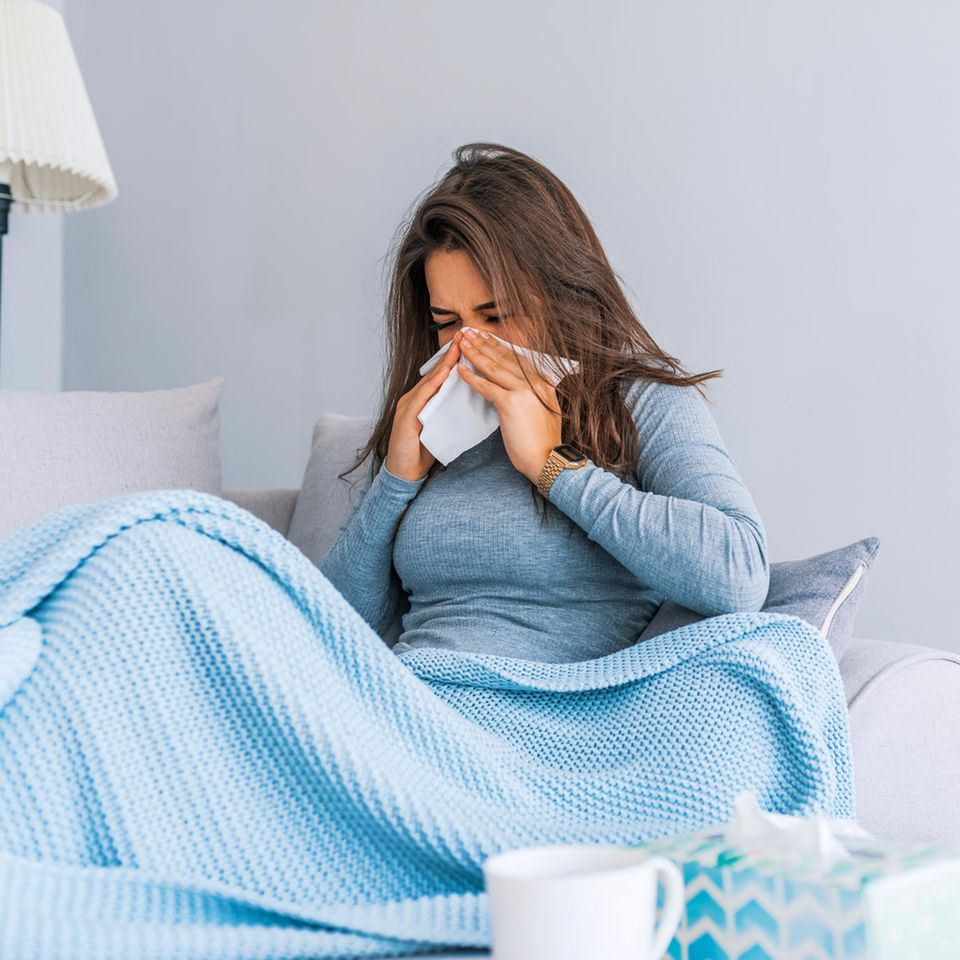 Superinfektion: Kranke Frau im Bett