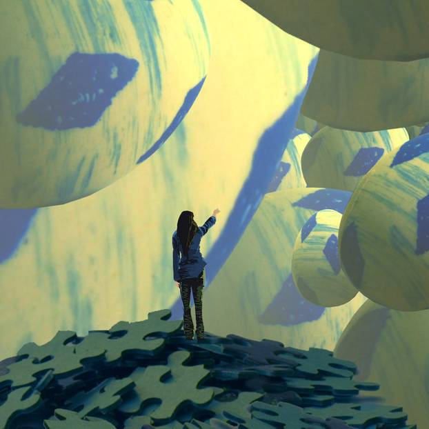 Traumdeutung: Frau steht auf einen Berg aus Puzzle