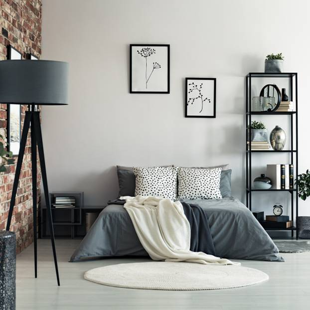 Modern wohnen: Schlafzimmer in grauen Farben und Steinwand