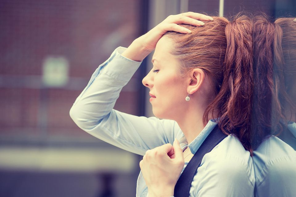 Stress-Symptome: Gestresste Frau
