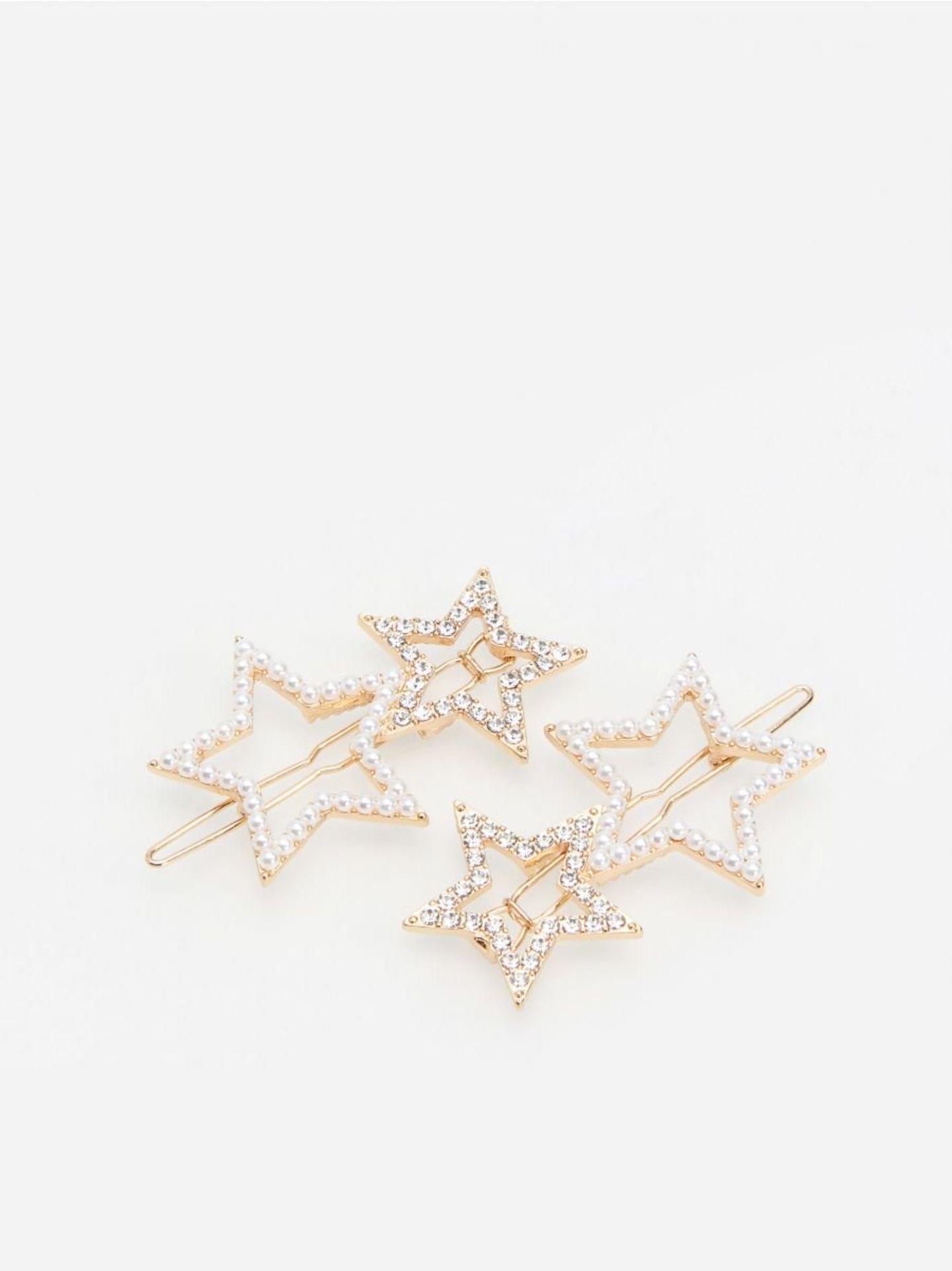 Haarspange mit glitzernden Sternen