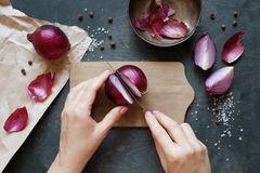 Onions in socks: woman cuts onions