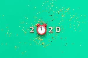 Uhr mit Glitter auf grün