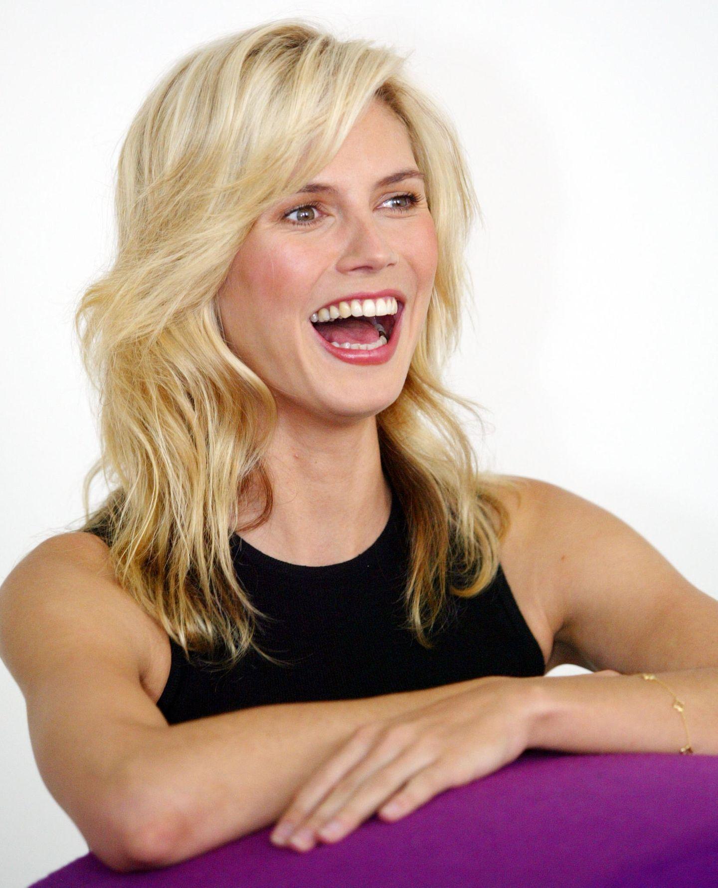 Heidi Klum: mit Föhnwelle und Stufenschnitt