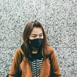 Coronavirus: Frau mit Mundschutz