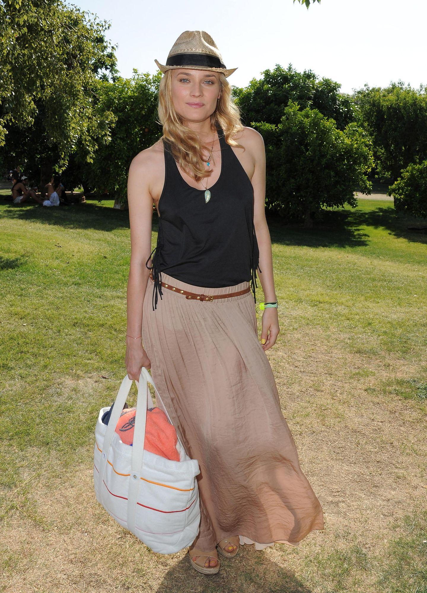 Promi-Looks: Diane Kruger mit Tasche und Hut