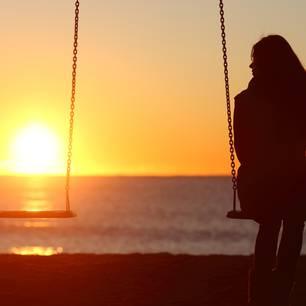 Einsame Frau am Strand