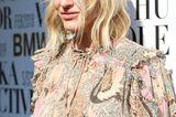 Midi-Hair: Frau mit blonden Wellen