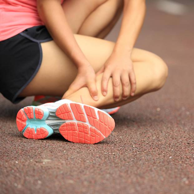 Muscle cramps: woman with cramp in her leg