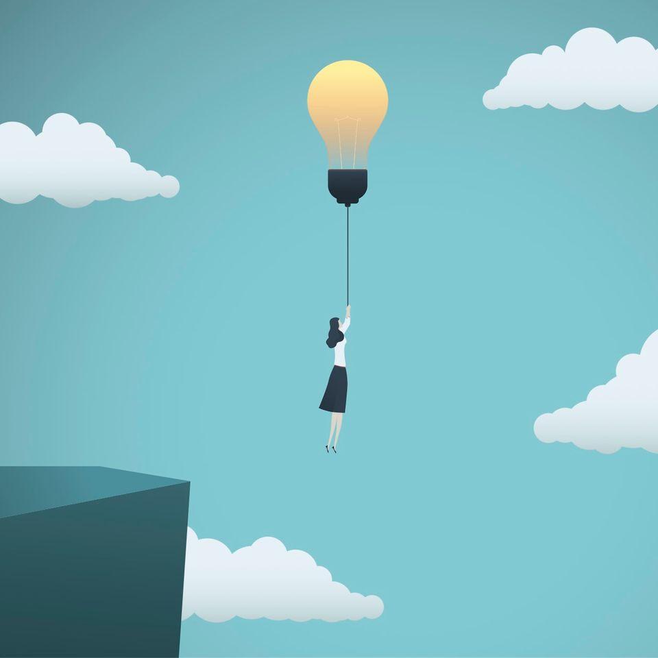Horoskop: Illustration einer Frau, die an einer Lampe über einen Abgrund schwebt
